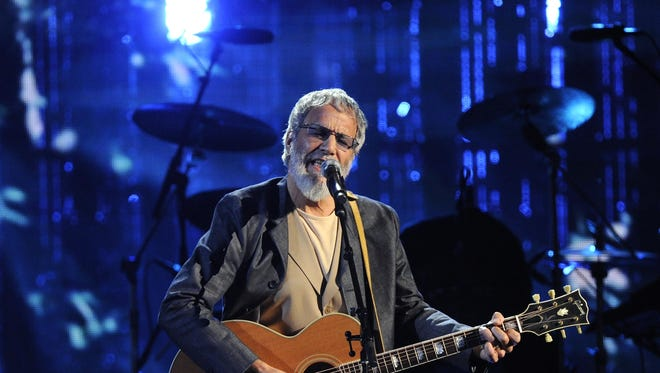 "In this April 10, 2014 file photo, Hall of Fame Inductee Cat Stevens performs at the 2014 Rock and Roll Hall of Fame Induction Ceremony in New York. Stevens is taking the ""Peace Train"" back on the road. He announced Monday, Sept. 15, that he will make a brief concert tour in North America this December. He's also releasing a blues album in October produced by Rick Rubin."