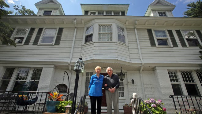 Seymour and Audrey Topping have lived  on Heathcote Road in Scarsdale since 1967. After the recent property tax revaluation in Scarsdale, the Toppings, photographed July 28, have seen the taxes on their home rise from $43,415 a year to $85,704.