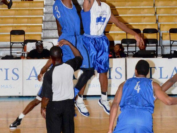 MTSU guard Joshua Phillips battles an Atlantis All-Stars player during Friday night's game in the Bahamas.