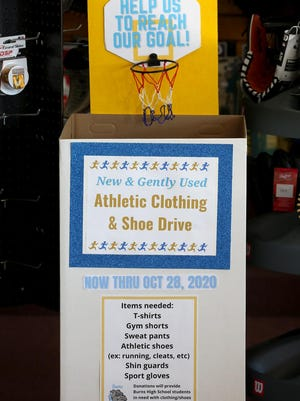 A donation box sits at S & M Sport Shop in Shelby on Wednesday. Gently used athletic wear and shoes can be donated to the boxes to benefit students at Burns High School.