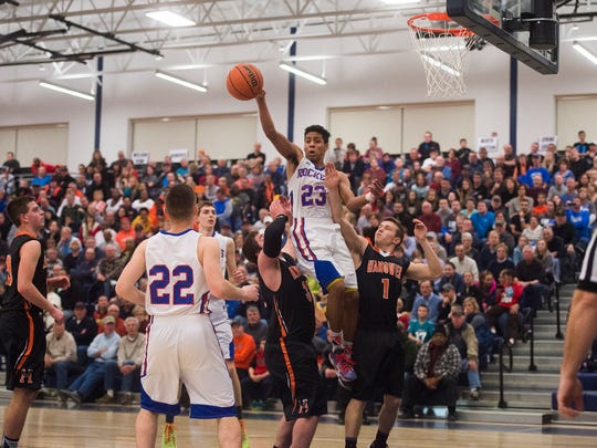 Spring Grove's Eli Brooks grabs a rebound and aims a pass to teammate Liam Flaherty against Hanover on Feb. 5, 2016 at West York High School.