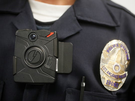 This Jan. 15, 2014 file photo shows a Los Angeles Police officer wearing an on-body cameras during a demonstration for media in Los Angeles.