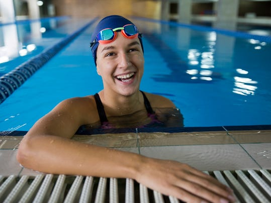 """Kosovo swimmer Rita Zeqiri smiles during her training session in the village of Hajvalia near Kosovo capital Pristina on Tuesday, July 19, 2016. Zeqiri, a 20 year old law student, will swim in backstroke event on  Aug. 7. """"Taking part in the first Olympic Games for Kosovo is an honor. I'm prepared well and I will do my best to represent my country as best as I can,"""" Zeqiri told The Associated Press at her training pool. Kosovo, will take part at its first-ever Olympics since it declared independence eight years ago. (AP Photo/Visar Kryeziu)"""