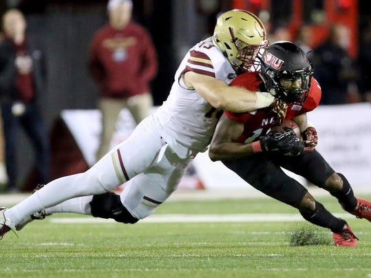 Northern Illinois' Spencer Tears catches a pass as he takes a hit from Boston College's Connor Strachan during an NCAA college football game Friday, Sep. 1, 2017, in DeKalb, Ill. (Matthew Apgar/Daily Chronicle via AP)