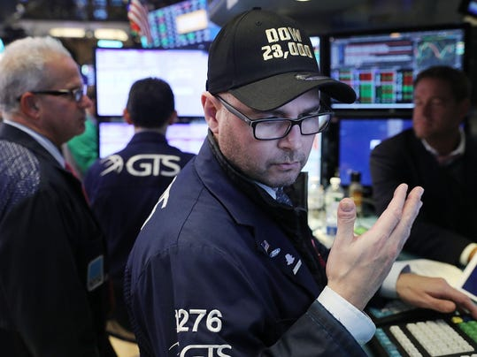 Dow Crosses 23,000 For First Time As Markets Continue Rally