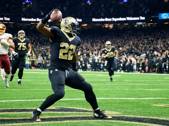 Saints running back Mark Ingram III celebrates after scoring a touchdown as The New Orleans Saints take on The Washington Redskins in the Mercedes-Benz Superdome in New Orleans, Sunday, Nov. 19, 2017.   (Scott Clause/The Daily Advertiser via AP)