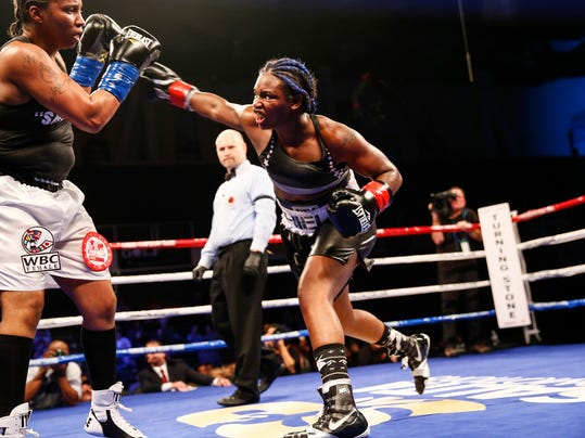 In a photo provided by Showtime, Claressa Shields throws a right at Tori Nelson during a boxing bout Friday night, Jan. 12, 2018, in Verona, N.Y. Shields scored a unanimous 10-round decision to retain her women's WBC and IBF super middleweight world titles. (Stephanie Trapp/Showtime via AP)
