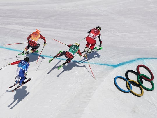 From left, ArnaudBovolenta, of France, DaveDuncan, of Canada, KevinDrury, of Canada, and Russian athlete Sergey Ridzik run the course during the men's ski cross semifinal at Phoenix Snow Park at the 2018 Winter Olympics in Pyeongchang, South Korea, Wednesday, Feb. 21, 2018. (AP Photo/Felipe Dana)