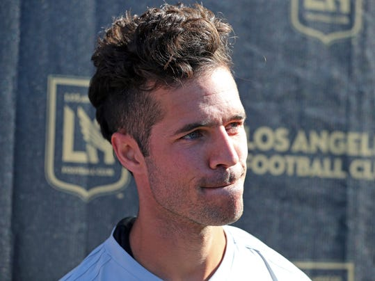 FILE - In this Jan. 22, 2018, file photo, LAFC's Benny Feilhaber talks to reporters during the introduction of players and coaches at the MLS soccer club's first training camp in Los Angeles. Feilhaber and his teammates begin LAFC's inaugural season with the first game in franchise history in Seattle on Sunday, March 4, 2018. (AP Photo/Reed Saxon, File)