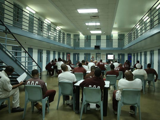 Prison inmates learn credit, banking, and personal finance to ease re-entry into the world of money