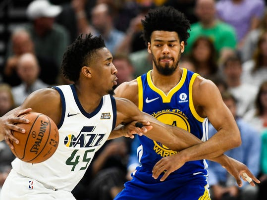 Utah Jazz guard Donovan Mitchell (45) attempts to drive past Golden State Warriors guard Quinn Cook (4) in the first half of an NBA basketball game Tuesday, April 10, 2018, in Salt Lake City. (AP Photo/Alex Goodlett)