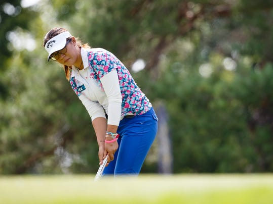 Lydia Ko, of New Zealand, putts on the first hole during the second round of the Marathon Classic LPGA golf tournament at Highland Meadows Golf Club in Sylvania, Ohio, Friday, July 18, 2014. (AP Photo/Rick Osentoski)