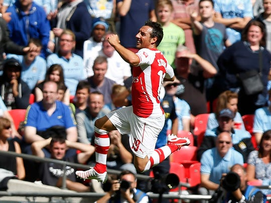 Arsenal's Santi Cazorla celebrates his goal against Manchester City during their English Community Shield soccer match at Wembley Stadium in London, Sunday, Aug. 10, 2014. (AP Photo/Sang Tan)
