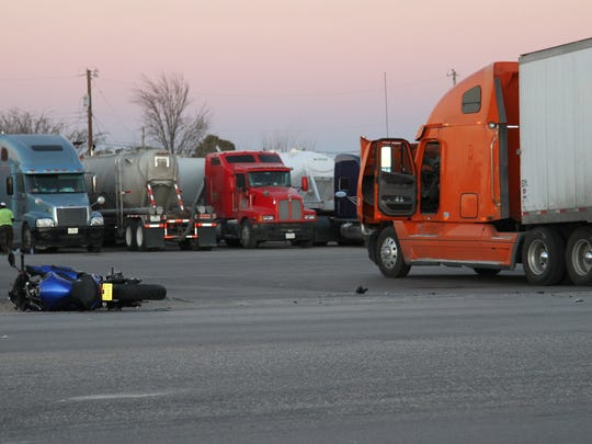 A semi-truck and a motorcycle were in a crash.