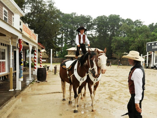 Under the watchful eye of his dad, Shane, junior cowboy Clay Karson takes the reins as he rides a pair of horses Roman-style at Frontier Town.