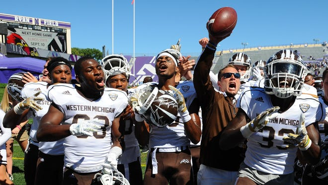 Western Michigan head coach P.J. Fleck, second from right, and players react after beating Northwestern 22-21 after an NCAA college football game in Evanston, Ill, on Sept. 3, 2016. The 35-year-old Fleck still talks with the same kind of energy he showed when he first took over the job before the 2013 season, and the program's catchphrase of Row the Boat resonates a little more when the team is winning.