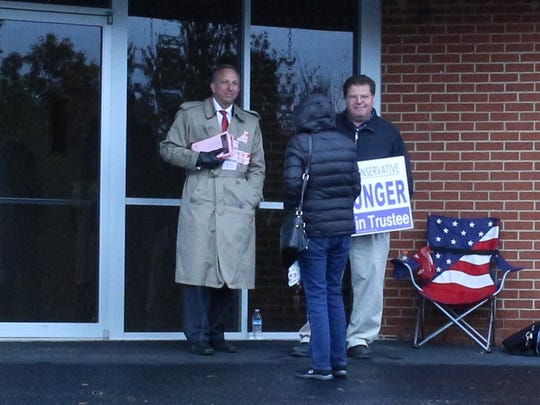 Colerain Township trustee candidates Jeff Ritter and Dan Unger talk with a voter at White Oak Christian Church.