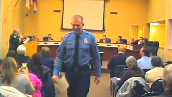 Officer Darren Wilson, shown on Feb. 11, 2014, told the grand jury that he feared for his safety while confronting unarmed teen Michael Brown.