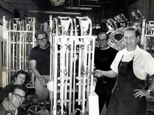 Daniel Thompson, far left, with bagel machines, employees at Thompson Bagel Machine Manufacturing Corporation in 1968.