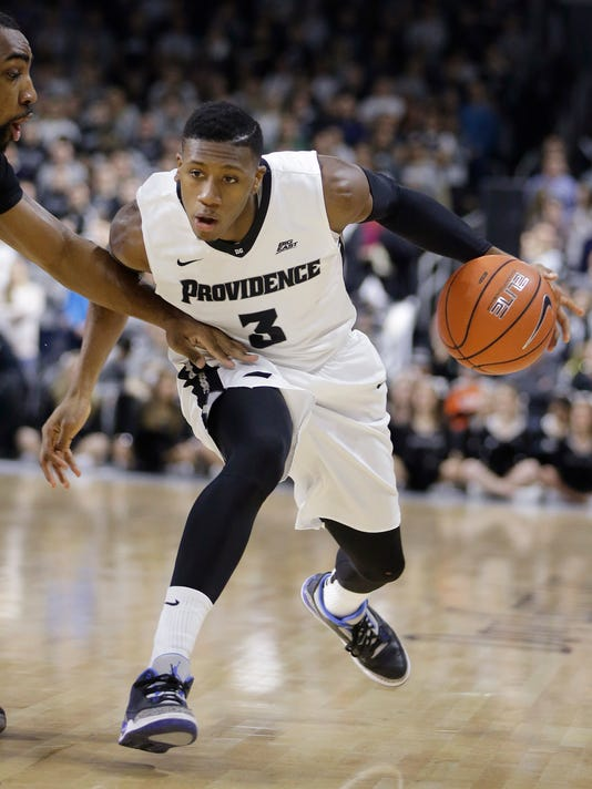 Providence guard Kris Dunn (3) drives to the hoop past Butler forward Roosevelt Jones (21) during the first half of an NCAA college basketball game  Tuesday, Jan. 19, 2016, in Providence, R.I. (AP Photo/Stephan Savoia)