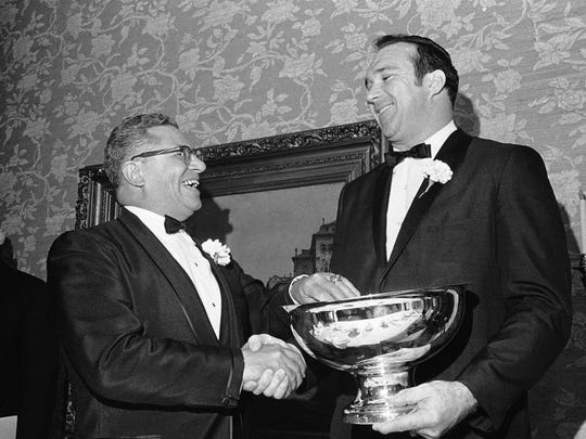 Vince Lombardi, left, new coach of Washington Redskins, congratulates Doug Atkins, defensive end of New Orleans Saints, for being awarded first Vince Lombardi Dedication Award, at the Wisconsin Sports Writers Dinner on Feb. 9, 1969.