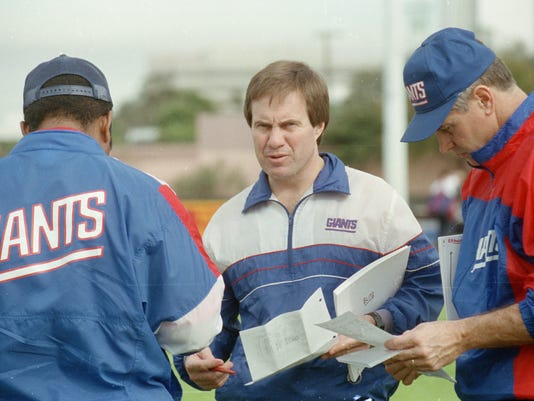 """FILE - In this Jan. 23, 1991, file photo, New York Giants defensive coordinator Bill Belichick, center, goes over the defensive game plan with other coaches as they prepare for Super Bowl 25 against the Buffalo Bills, in Tampa, Fla. The Giants defeated the Bills 20-19 in Super Bowl 25 on Jan. 25, 1991. The top """"D"""" almost always prevails against the top """"O,"""" going 5-1 so far when those teams meet to determine a champion _ even though each offense was led by a quarterback who is in the Pro Football Hall of Fame (or, in the most recent case, is expected to be). (AP Photo/File)"""