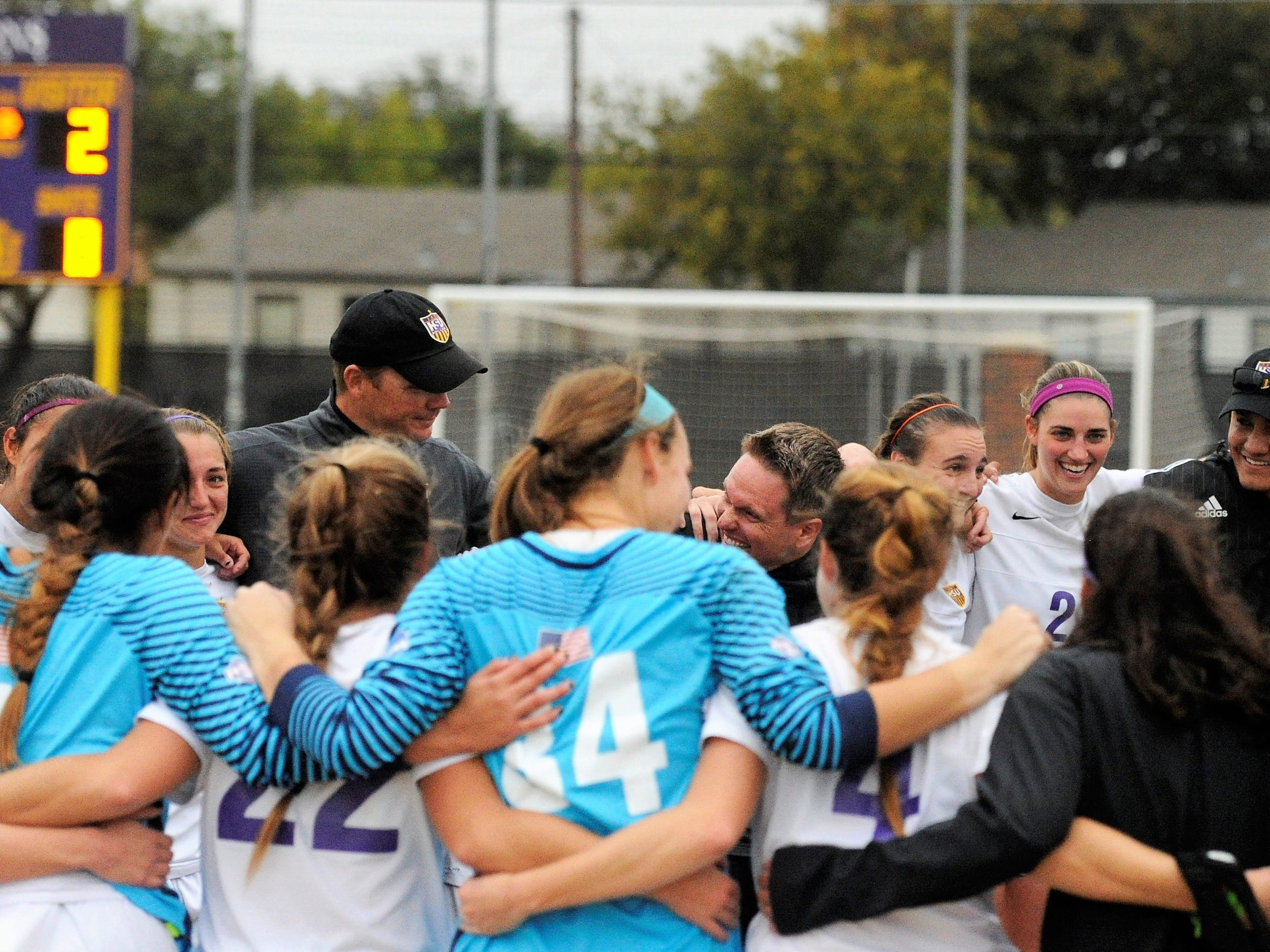 Hardin-Simmons head coach Marcus Wood talks to his team following an NCAA Division III second round game against Trinity. The No. 3 Cowgirls scored twice in the final 10 minutes to win 3-2.
