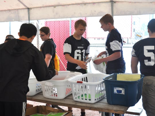 Volunteers from the Nekoosa High School Football Team sort donations during the 2017 Stuff the School Bus event.