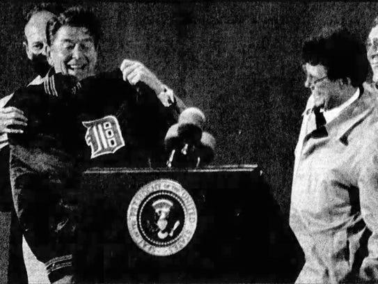 President Ronald Reagan holds up Tigers shortstop Alan