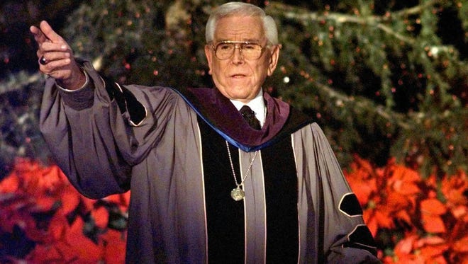 "In this Dec. 24, 1997, file photo, Rev. Robert H. Schuller delivers one of seven candlelight Christmas Eve services from the Crystal Cathedral pulpit in Garden Grove, Calif. Schuller, the Southern California televangelist who brought his message of ""possibility thinking"" to millions, died early Thursday, April 2, 2015, in California. He was 88."