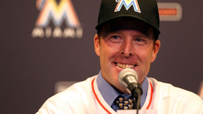 MIAMI, FL - NOVEMBER 02:  Manager Mike Redmond of the Miami Marlins speaks to the media after being named manager at Marlins Park on November 2, 2012 in Miami, Florida.  (Photo by Marc Serota/Getty Images)