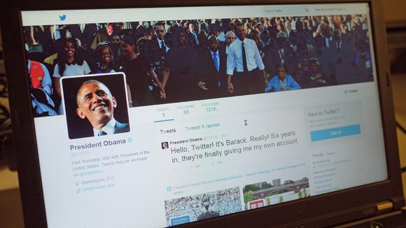 An illustration shows President Obama's Twitter page