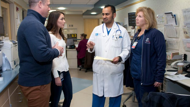 John Brogan (left) and Angela Cicchino, both Toms River are Recovery Specialists in Barnabas Health's new Opioid Overdose Program. The program uses ex addicts to get drug abusers into treatment. They talk with Dr. Vikram Varma, Community Med Ctr Chairman of Emergency Services and ER nurse Michelle DeSalvo (right)—February 26, 2016-Toms River NJ.-Staff photographer/Bob Bielk/Asbury Park Press