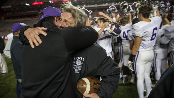 Head coach Jerry Schulte is congratulated at the end of the game. South Plainfield vs Rumon-Fair Haven Central Group III sectional title game at High Point Solutions Stadium. 