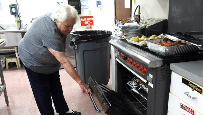 Gladys Ross helps prepare lunch on Thursday at Hopewell Industries. Hopewell recently received an $8,500 grant from the Coshocton Foundation and will use the money to replace the stove.