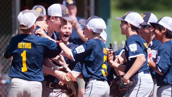 Essex Junction players celebrate their 10-0 win over Brattleboro in Saturday's 11-12-year-old Little League baseball state championship game in Essex.