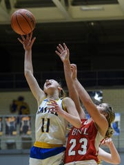 Castle's Carly Harpenau (11) gains possession of a rebound against Bedford North Lawrence's Dwayne Lautier-Ogunleye in the Knights' win in a battle of state-ranked teams.