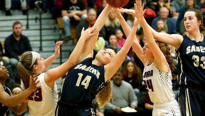 Susquehanna Valley's Alexis Drake (14) takes control of rebound during Southern Tier Athletic Conference girls basketball championships, Elmira vs. Susquehanna Valley, held at Maine-Indwell High School, February 14, 2018. Susquehanna Valley won with a final score of 45-66.
