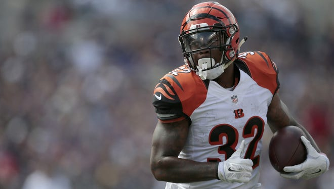 Cincinnati Bengals running back Jeremy Hill looks for running room on Sunday against Baltimore. He has 123 yards through three games.
