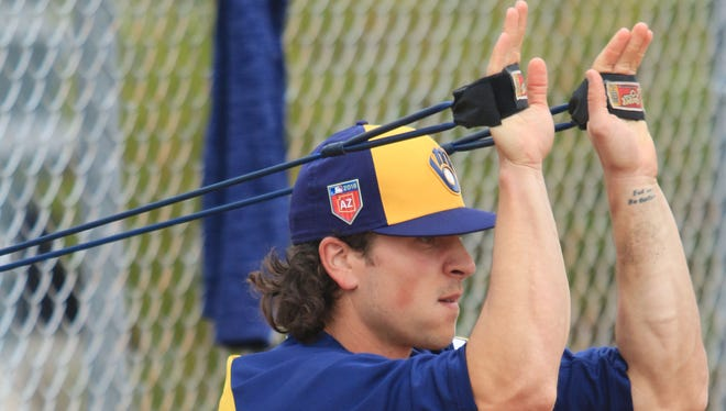 Brewers pitcher Taylor Williams stretches prior to drills Friday.
