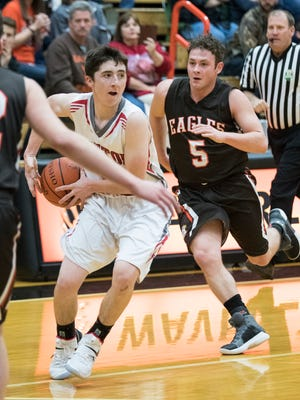 Piketon's Scott Lightle looks for an open teammate during the second quarter of Friday's 69-62 loss to Eastern in the Pike County Holiday Classic semifinals.
