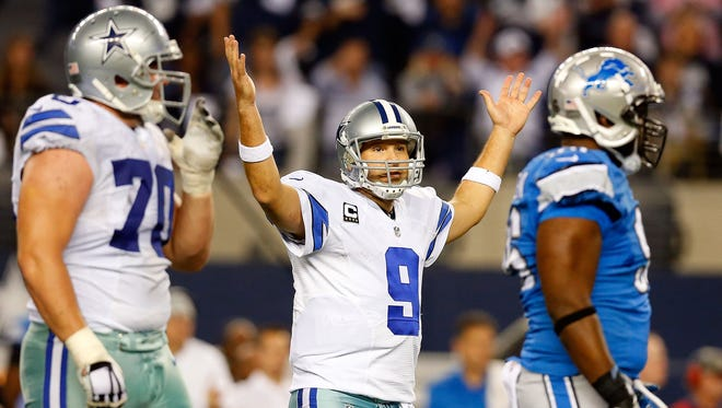 Tony Romo of the Dallas Cowboys looks toward the officials after a play against the Detroit Lions on Jan. 4, 2015.