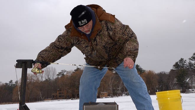 These homemade ice-fishing rigs automatically set the hook when a fish strikes.