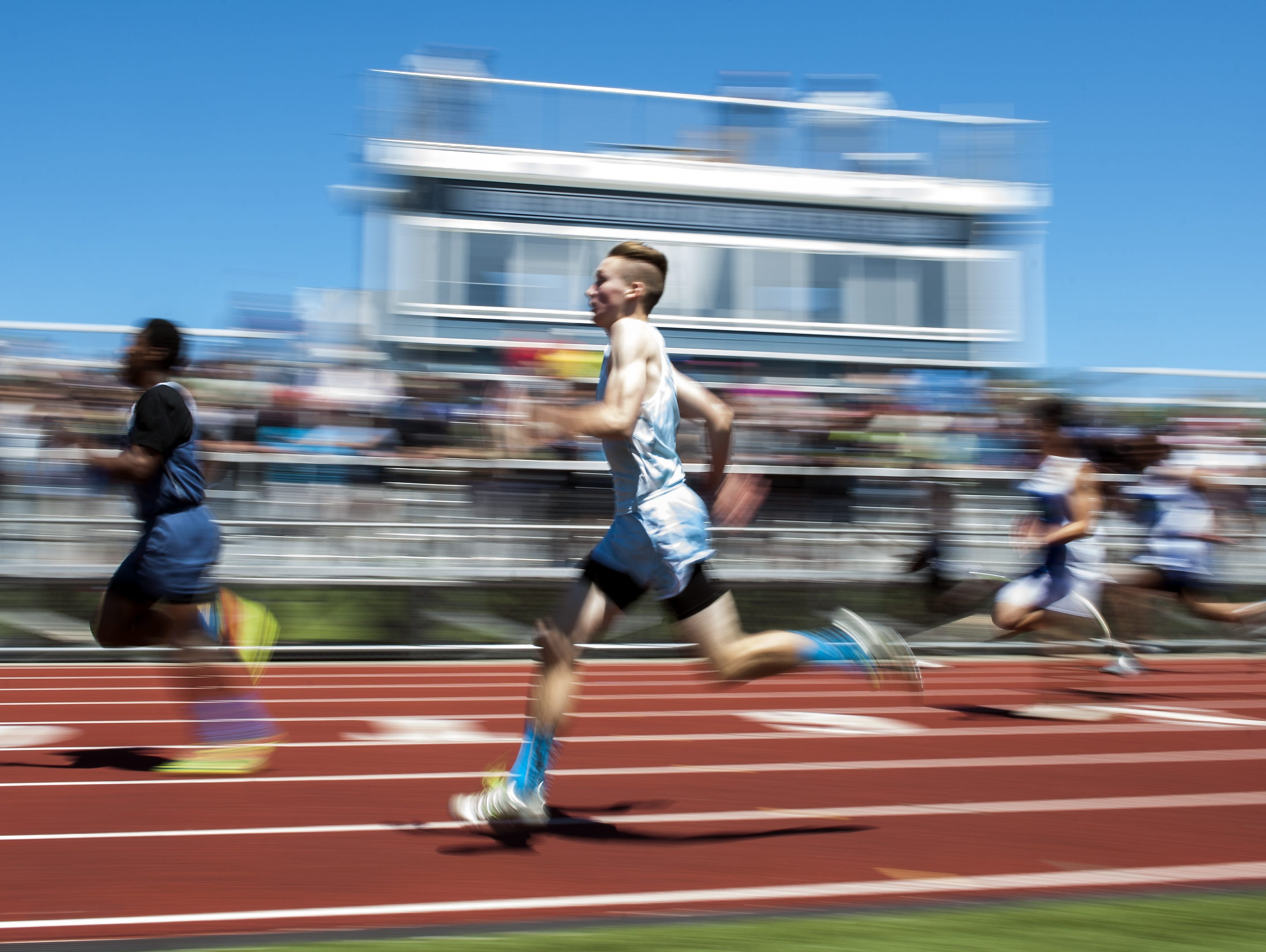 Racers compete in the 800m dash during the high school track and field state championship meet at Burlington High School on Saturday, June 6.