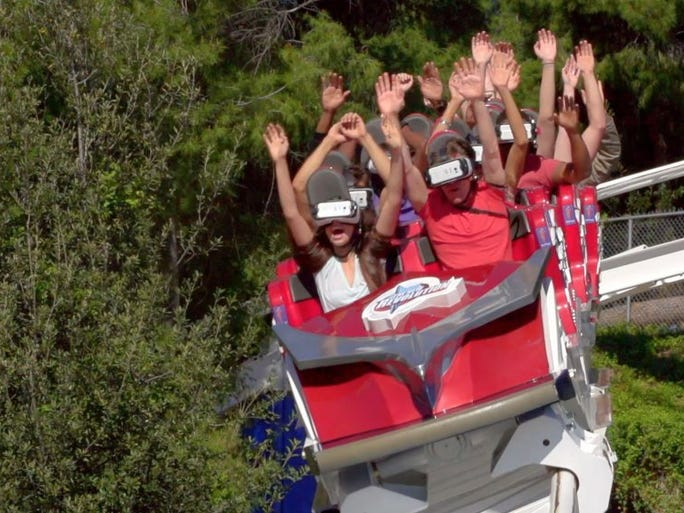 Photo Courtesy Six Flags Magic Mountain Members of the media ride the New Revolution at Six Flags Magic Mountain on Friday. The revamped coaster now has a virtual reality option.
