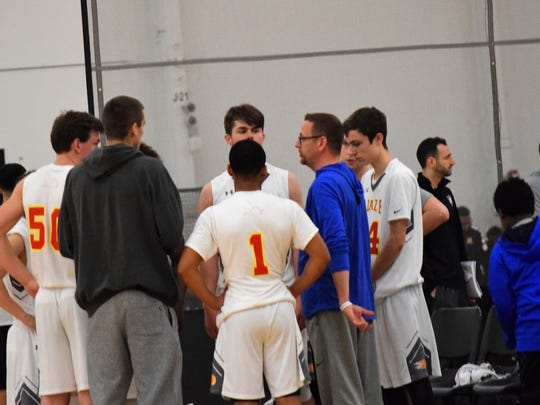 Head coach Chad Seibert talks with his AAU Blaze team during Sunday's loss to CBSA Hoyas in the semis of the Hoop Group Spring Jam Fest in Manheim, Pa.