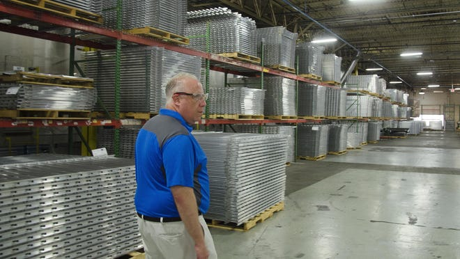 Ideal Aluminum co-owner Michael Siegel walks through the manufacturing area of his St. Augustine factory in 2015.