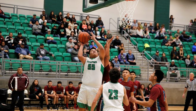 Farmington's Kobe Shorty puts up a shot during the first quarter against Shiprock Thursday at Scorpion Arena.