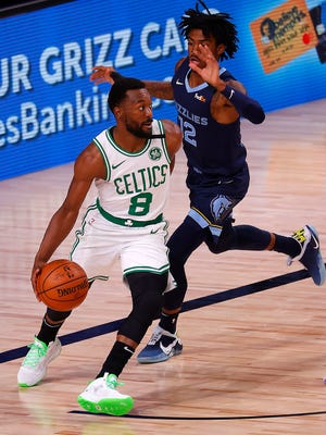 Celtics guard Kemba Walker, left, tries to drive past Ja Morant of the Grizzlies during a game on Tuesday. Walker had been nursing a sore knee but appears to be 100% for the playoffs.
