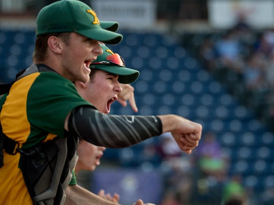 Saint Xavier's bench cheers after a two run RBI in the first inning of the state championship baseball game played against Highlands High School at Whitaker Bank Ballpark in Lexington, Ky, June 16, 2018.